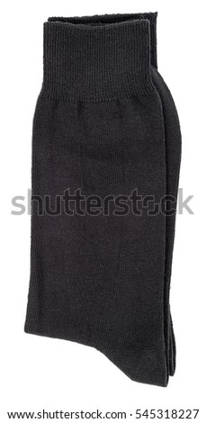 Black socks folded isolated on a white background. Clipping paths included.