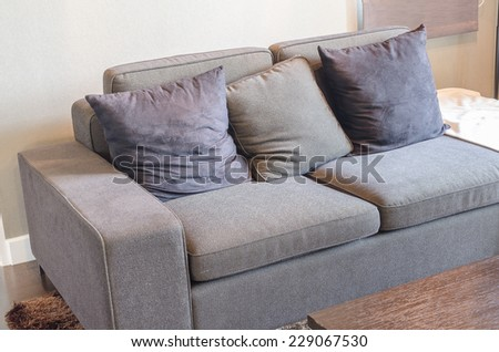 black sofa in living room with wooden table