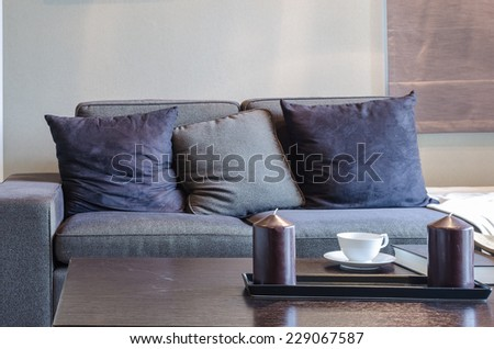 black sofa in livivng room with wooden table at home