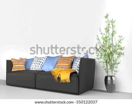 Black sofa with lots of stuff on it