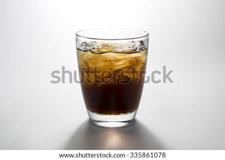 black soft drink on white background