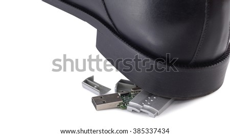Black sole of boot on broken flash drive isolated on white background. Clipping path included.