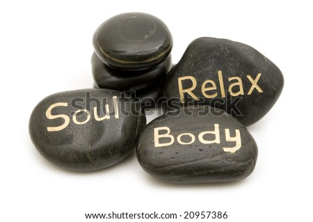 black spa massage stones on white background