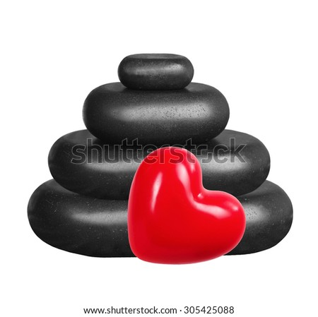 Black spa stones and red heart isolated on white background - stock photo
