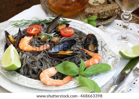 black spaghetti with mussels, shrimp and tomatoes