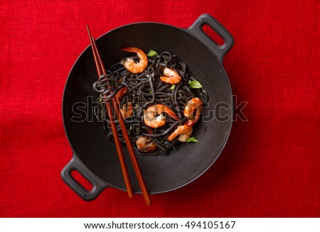 Black spaghetti with shrimp, selective focus