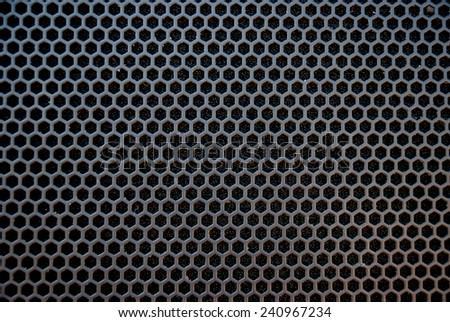 Black speaker grid texture. Industrial background. - stock photo