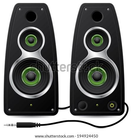 Black stereo speaker set with plug on white - stock photo