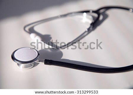 Black stethoscope in blue shade, close up