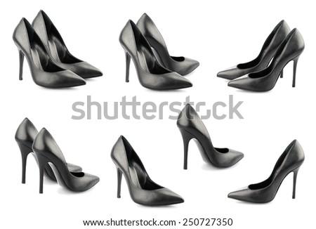 Black stilletos isolated on white background. - stock photo