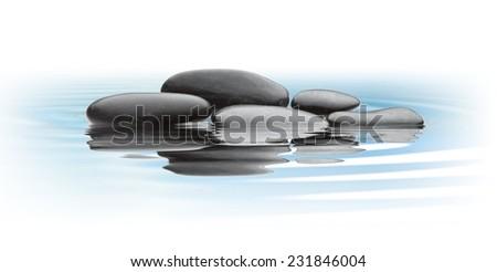 black stones on water - stock photo