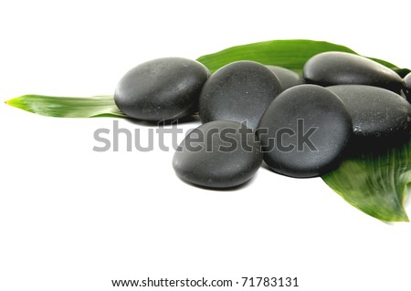 black stones with green bamboo leaf