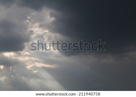 Black storm clouds with sun rays. Background - stock photo