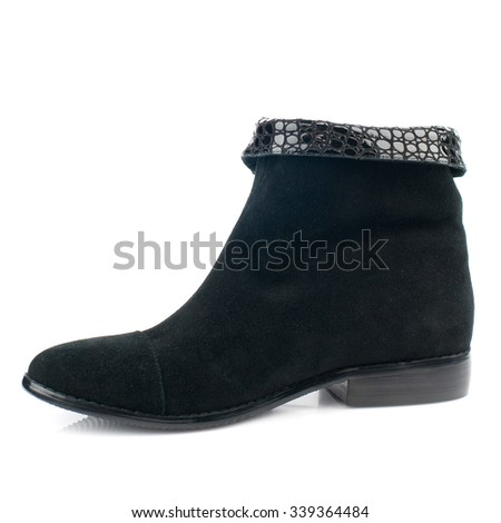 Black suede boot isolated on white background. - stock photo