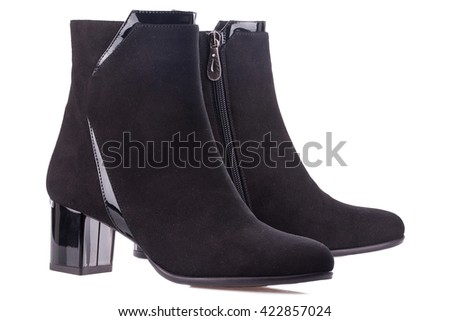 Black suede boots isolated on white background. - stock photo