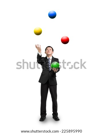 black suit businessman juggling colorful balls isolated on white - stock photo