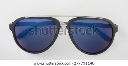 Black sunglasses with blue lenses in white background - stock photo