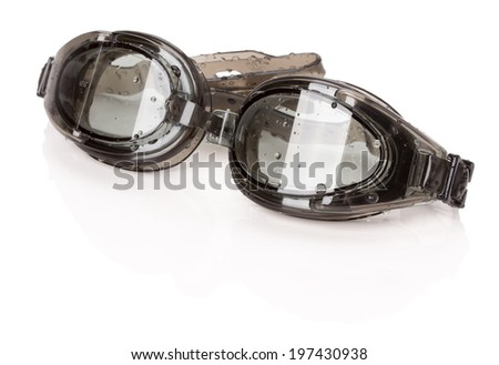 black swimming goggles on the white background