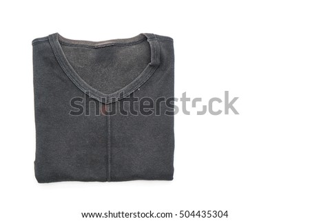 black t-shirt folded on white background