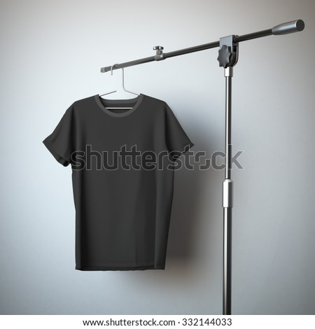 Black t-shirt hanging on the tripod