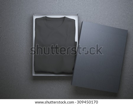 Black t-shirt in a nice cardboard packaging - stock photo