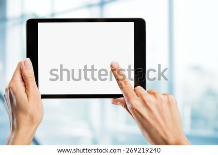 Black. Tablet computer isolated in a hand on the white backgrounds. - stock photo