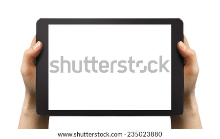 Black tablet in woman's hands isolated on white in horizontal mode, ipad style. - stock photo