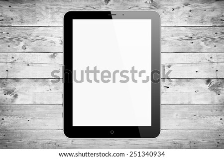 Black tablet pc same with ipade over wood background - stock photo