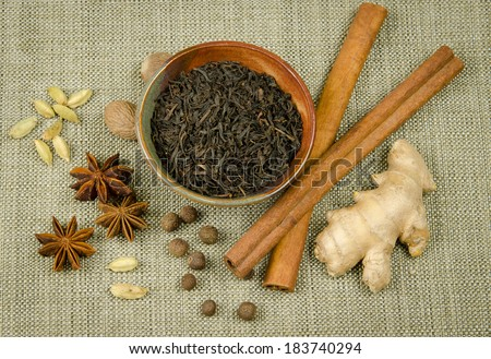 Black tea and spices for Garam Masala Chai Tea - stock photo