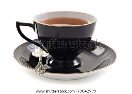 Black tea cup on a white background with space for text - stock photo