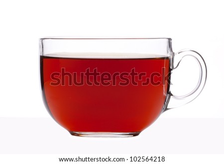 black tea in a translucent glass cup on a white background - stock photo
