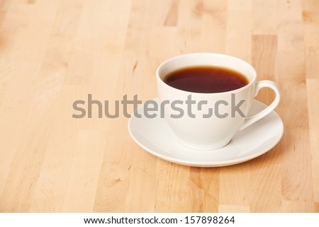 Black tea in cup on the table  - stock photo