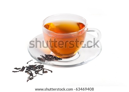 Black tea in the transparent cup on the white - stock photo
