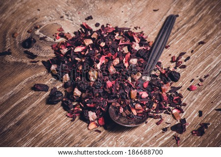 black tea leafs with fruits - stock photo