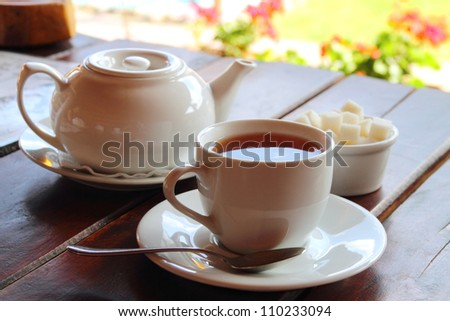 Black tea served on the wooden table - stock photo