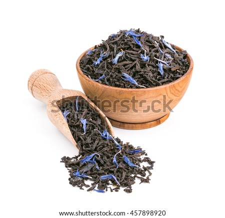 Black tea with blue petals in a wooden bowl isolated on white - stock photo
