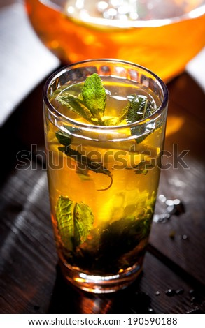 black tea with mint on dark background