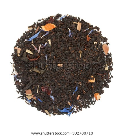 Black tea with pieces of dried fruit and hibiscus flowers isolated on white top view - stock photo