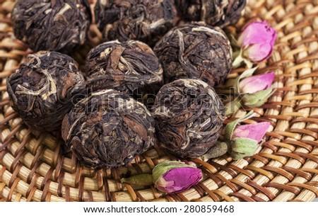 Black tea with roses. - stock photo