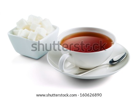 Black tea with sugar cubes isolated on white background - stock photo