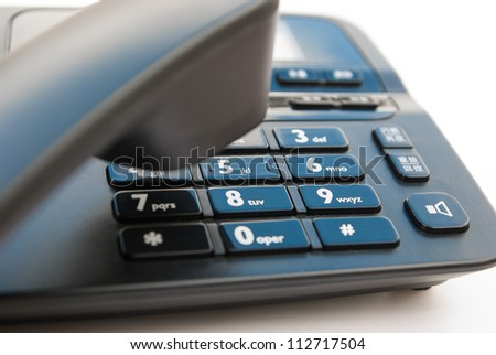 black telephone on blue tone - stock photo