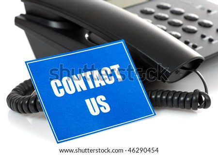 black telephone on white background with card - stock photo