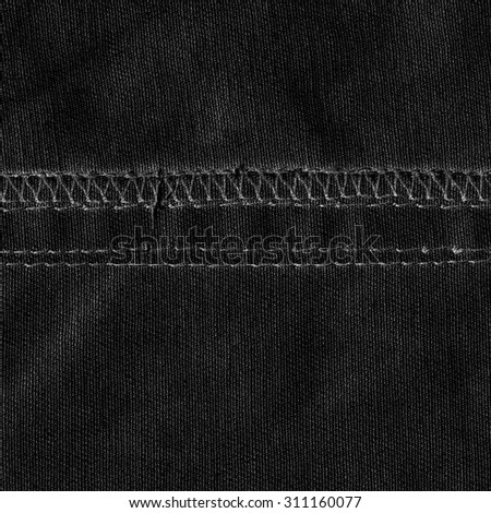 black  textile texture decorated with seams