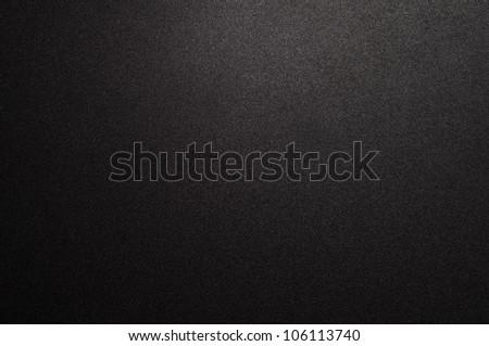 Black texture with spotlight - stock photo