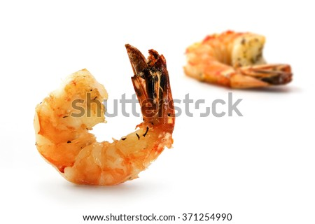 black tiger prawns, roasted with herbs and spices as finger food appetizer on a festive party, closeup shot isolated with shadows on a white background, selected focus, narrow depth of field - stock photo