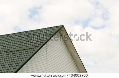 black tile roof of construction house with blue sky and cloud background