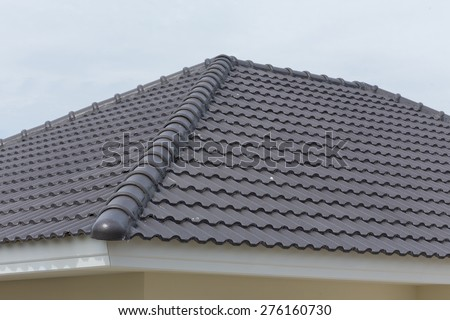 black tile roof on a new house - stock photo