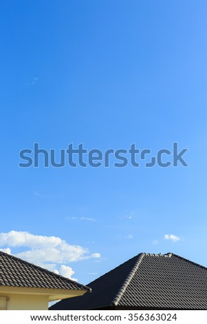 black tile roof on a new house with clear blue sky background