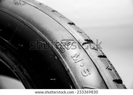 Black tire isolated on white background.