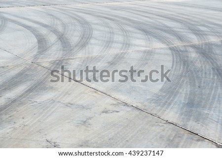 Black tire tracks on road, Racing curve.